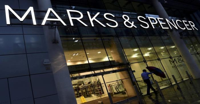 FILE PHOTO: A man leaving a Marks & Spencer store in London