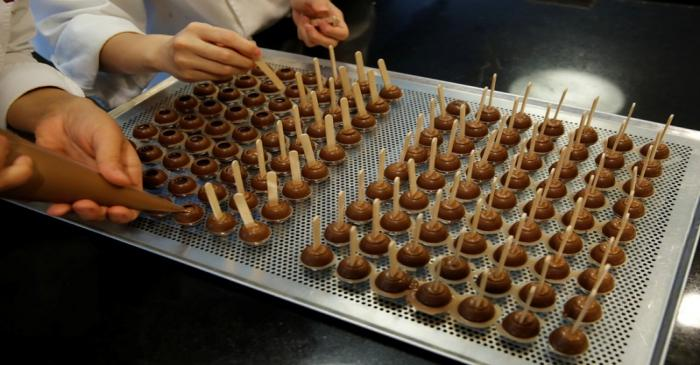 Empoyees of chocolate and cocoa product maker Barry Callebaut prepare chocolates in Zurich