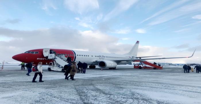 FILE PHOTO: Passengers board a Norwegian Air plane in Kirkenes
