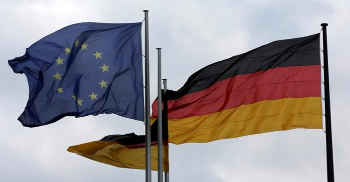 The European Union and German nation flags are pictured before a debate on the consequences of