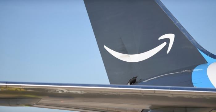 FILE PHOTO: A wide body aircraft emblazoned with Amazon's Prime logo is unloaded at Lehigh
