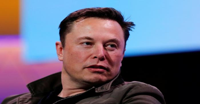 FILE PHOTO: SpaceX owner and Tesla CEO Elon Musk speaks during a conversation with legendary