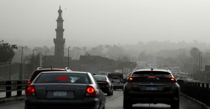 FILE PHOTO: Cars sit in traffic on El Sayeda Aisha Bridge during a sandstorm in Cairo