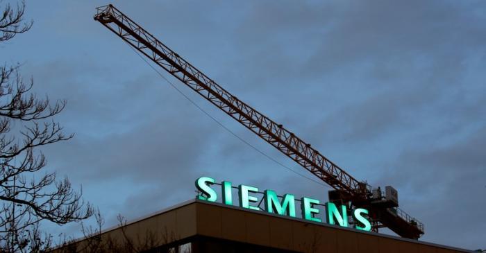 FILE PHOTO: Logo of German industrial group Siemens is seen in Zurich