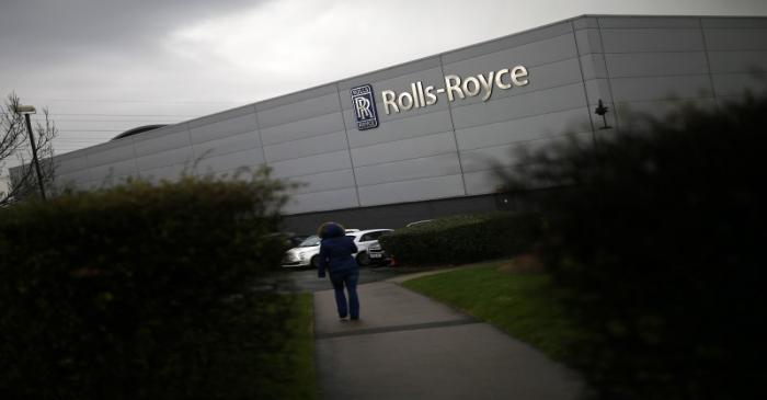 A worker walks into a Rolls Royce site in Derby