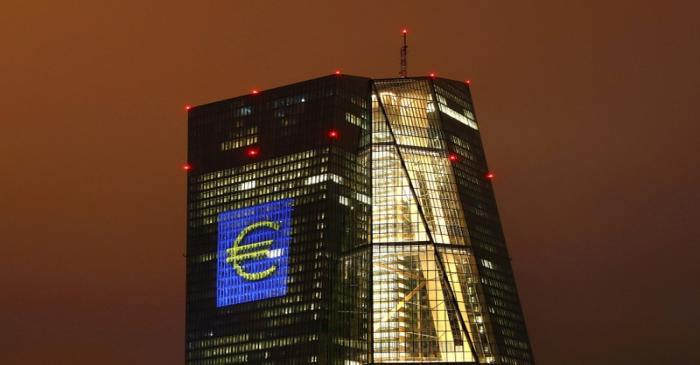 FILE PHOTO: Headquarters of the European Central Bank (ECB) is seen illuminated with a giant