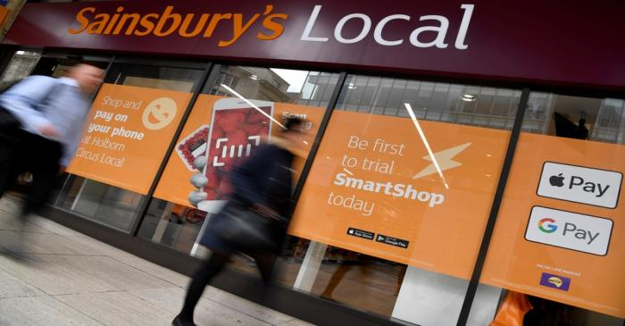 FILE PHOTO: Shoppers walk past the first 'till-free' Sainsbury's store in London, Britain