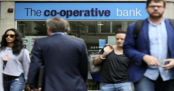 People walk past a branch of the Co-Operative Bank in central London