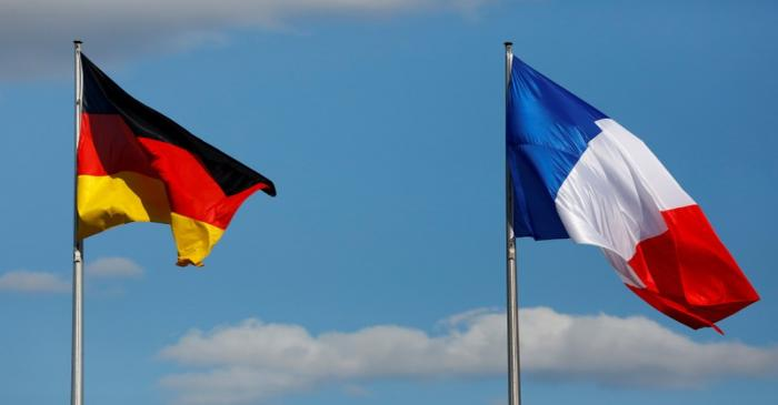 FILE PHOTO: The flags of Germany and France are seen in front of the the Chancellery, before