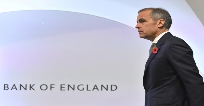FILE PHOTO: Bank of England Governor Mark Carney attends a Bank of England news conference, in