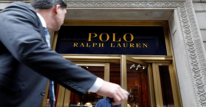 FILE PHOTO: A man walks past Ralph Lauren Corp.'s  flagship Polo store on Fifth Avenue in New