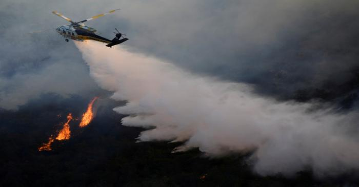 FILE PHOTO: A firefighting helicopter makes a water drop on the Getty Fire as it burns in the