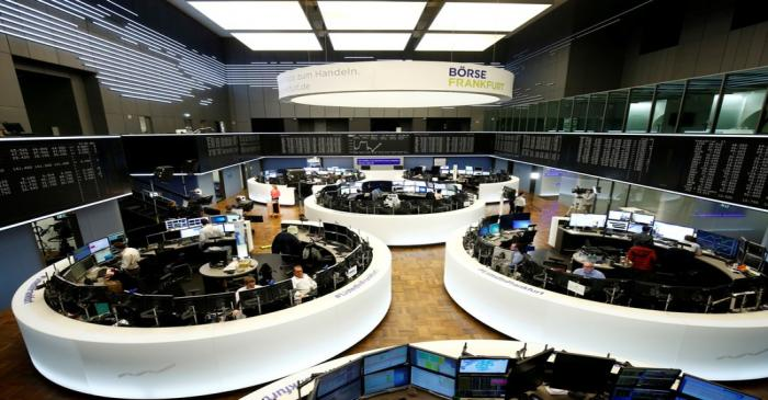 FILE PHOTO: Traders work at Frankfurt's stock exchange in Frankfurt