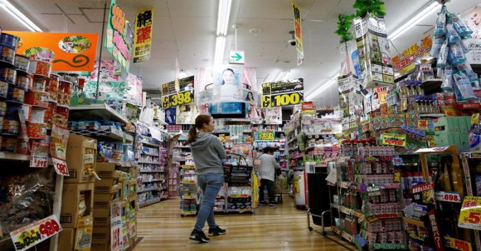 FILE PHOTO: Shoppers browse products at Japanese discount retailer Don Quijote Holdings' store