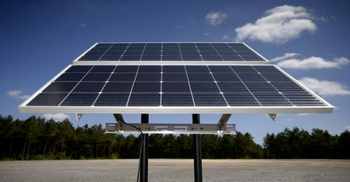 FILE PHOTO: FILE PHOTO: Solar panels are pictured at the BP America Gasosaurus Gas Unit well