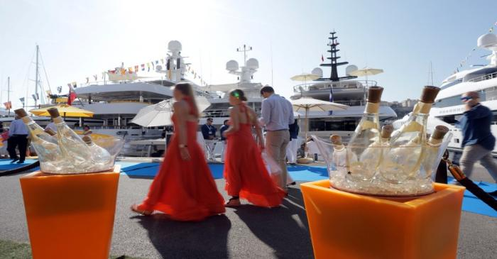 Visitors are seen during the Monaco Yacht show, one of the most prestigious pleasure boat show