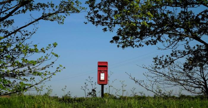 FILE PHOTO: A Royal Mail post box stands on the edge of a field near Lymm, northern England.