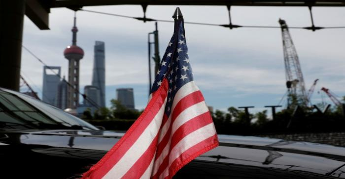 U.S. flag on an embassy car is seen outside a hotel in Shanghai