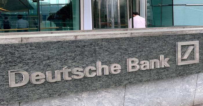 FILE PHOTO: The logo of Deutsche bank is seen in Hong Kong