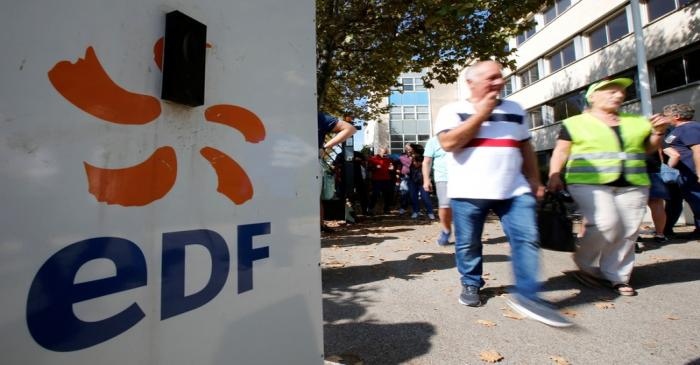 FILE PHOTO: Employees of France's EDF energy company attend a demonstration against the