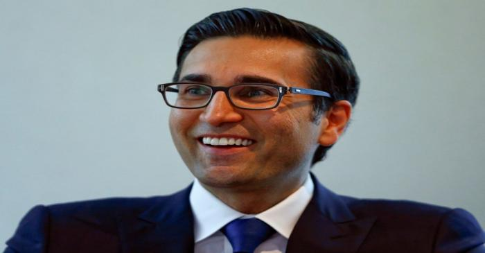 FILE PHOTO: Khan, CEO International Wealth Management of Swiss bank Credit Suisse, smiles