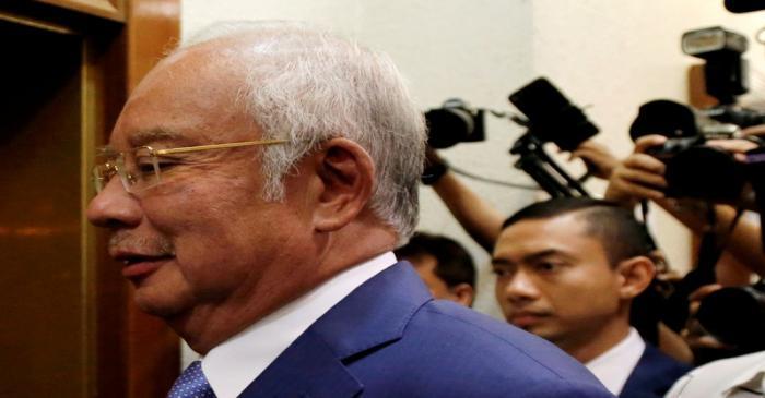FILE PHOTO: Former Malaysian Prime Minister Najib Razak arrives at Kuala Lumpur High Court in