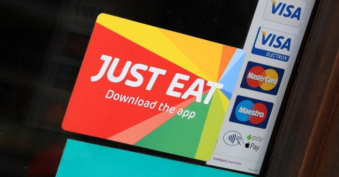FILE PHOTO: Signage for Just Eat is seen on the window of a restaurant in London