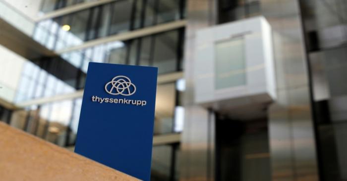 The logo of Thyssenkrupp is seen near elevators in its headquarters in Essen