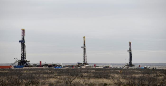 FILE PHOTO: Drilling rigs operate in the Permian Basin oil and natural gas production area in
