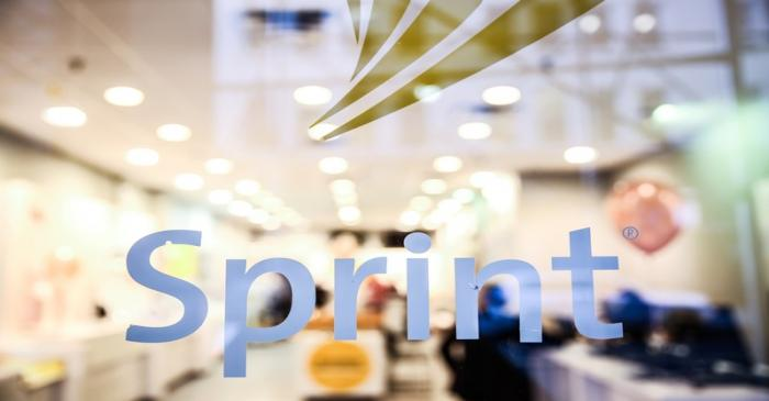 A Sprint sign is seen on top of a Sprint retail store in New York
