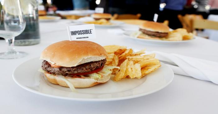 The completed plant-based hamburger is displayed during a media tour of Impossible Foods labs