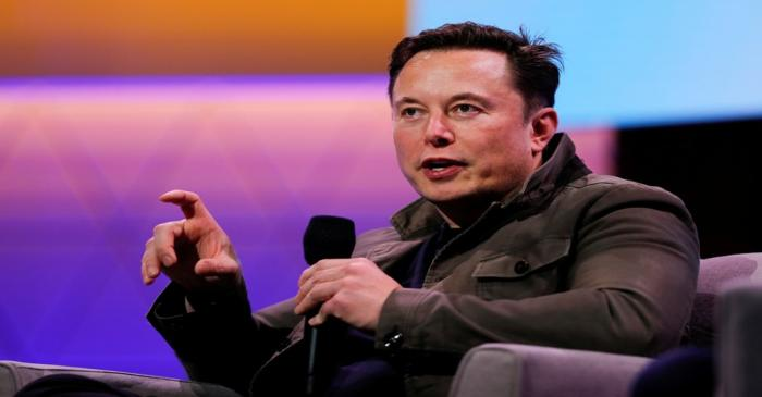FILE PHOTO: Tesla CEO Elon Musk gestures during a conversation at the E3 gaming convention in