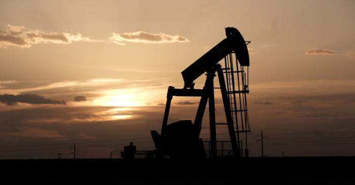 FILE PHOTO: Oil pump jacks work at sunset near Midland, Texas
