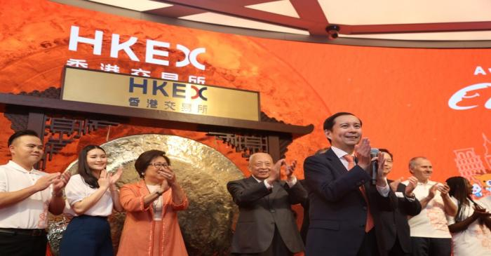 Daniel Zhang, Laura Cha and Tung Chee-hwa attend Alibaba Group's listing ceremony at the Hong