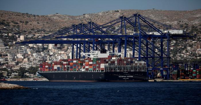 A cargo ship is moored at the Piraeus Container Terminal, near Athens