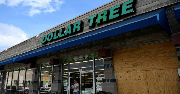 A customer walks out of a Dollar Tree discount store in Austin, Texas