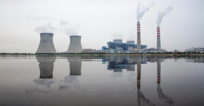 A power station of the State Development & Investment Corporation (SDIC) is reflected in a lake