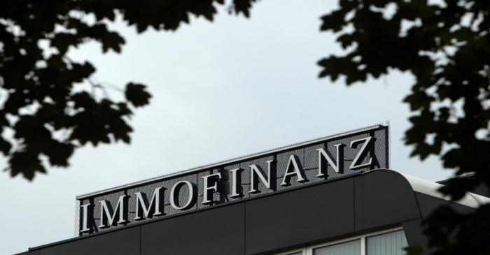 The logo of Austrian real estate group Immofinanz is pictured on top of the company's