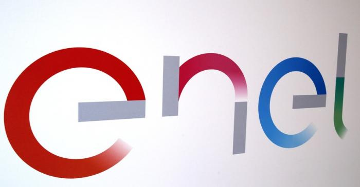 The new logo of Italy's biggest utility Enel is seen inside its flagship store in downtown