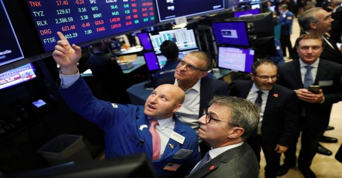 CEO of Kaleyra, Dario Calogero, looks up at a board before the company's IPO above the floor of