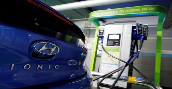 A Hyundai Motor's electric car IONIQ is charged at a electric charging station in Seoul