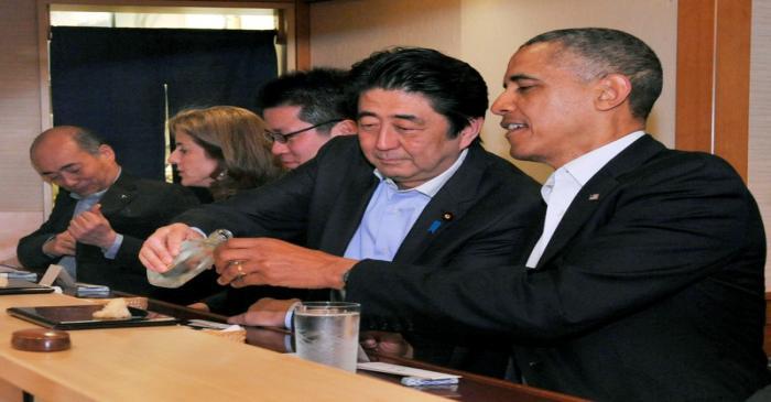 FILE PHOTO : Japanese Prime Minister Shinzo Abe pours sake for U.S. President Barack Obama as