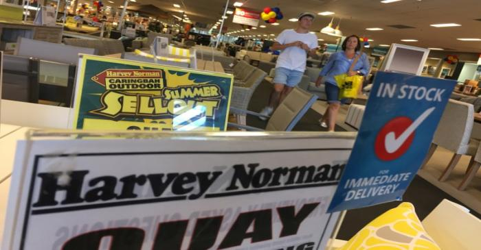 Shoppers walk the furniture showroom at a Harvey Norman outlet in Sydney