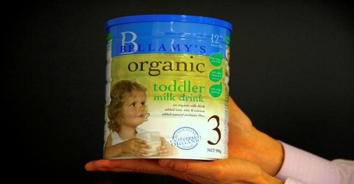 FILE PHOTO: A person holds a tin of Bellamy's organic toddler milk formula in Sydney