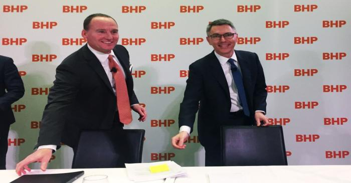 BHP Chairman Ken MacKenzie and Mike Henry are seen at a news conference to announce Henry as