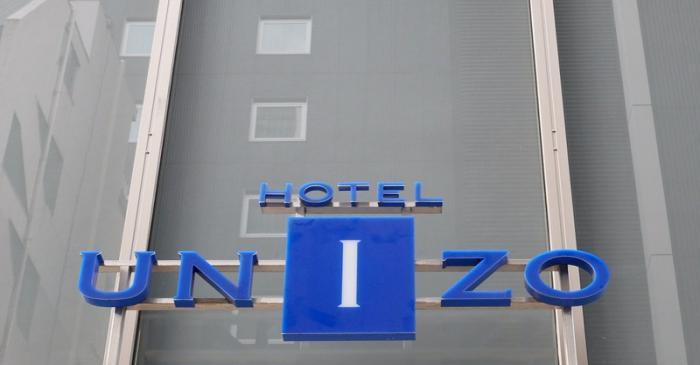 FILE PHOTO: The logo of Hotel Unizo, operated by Japanese hotel operator Unizo Holdings, is