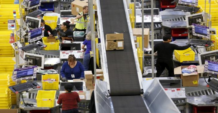 FILE PHOTO: Workers prepare orders at the Amazon Fulfillment Center in Tracy