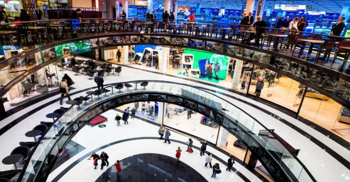 FILE PHOTO:  People walk through Mall of Berlin shopping centre during its opening night in