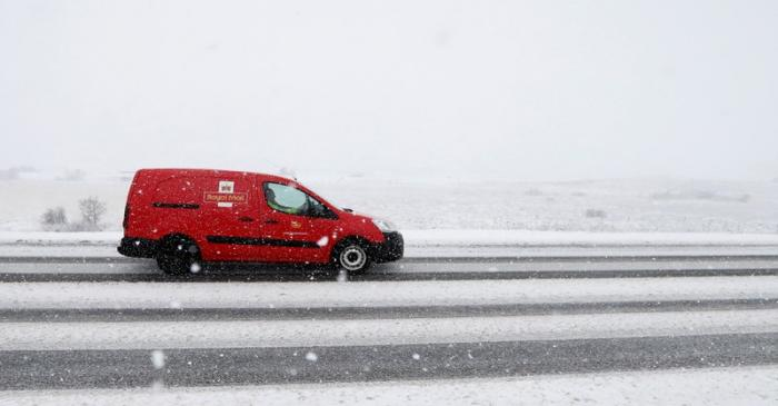 A Royal Mail van drives through the Drumochter Pass, Scotland