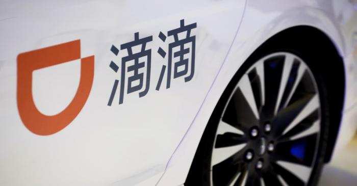 FILE PHOTO: The logo of ride-hailing company Didi on a car door